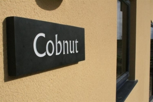 notgrove cotswold holiday cottage the grove cobnut sign